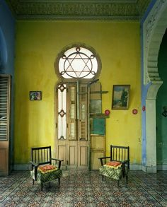 Yellow walls and geometric tiled floor. Havana 2010 Photo Copyrighted by Michael Eastman.
