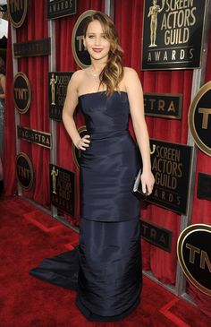 Jennifer Lawrence in a navy Dior Haute Couture dress and Chopard jewelry at the 2013 SAG Awards, where she won Best Actress for 'Silver Linings Playbook'