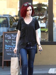 Star Tracks: Tuesday, June 21, 2016 - RED-HOT Lily Collins taps into the summer goth trend, thanks to her new hair color and all-black ensemble, while out and about in West Hollywood on Monday.