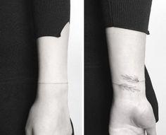 Delicate wrist tattoo by Jakub Nowicz