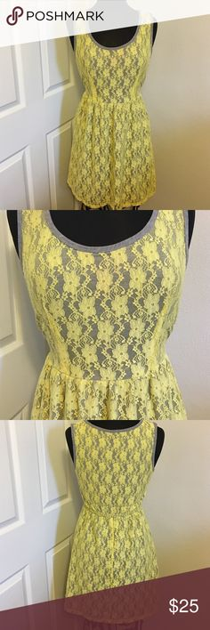 Yellow lace BeBop Dress Super cute! Made of Self: 92% Nylon 8% Spandex . Contrast 96% Polyester 4% Spandex .  Really comfortable elastic waist band . Wide shoulder straps to conceal bra . BeBop Dresses Mini