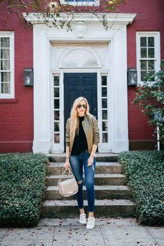 The Fall Jacket Trend To Try Now | A Pinch of Lovely. White top+ripped jeans+white sneakers+khaki bomber jacket+light taupe shoulder bag+sunglasses. Fall Outfit 2016