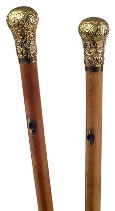 "An outstanding pair of late 18th to early 19th century walking, or ""coach"" sticks This pair has matching gold filled bulbous knobs with beautiful scrollwork floral repousse work with stippled ground, each marked ""Swaine & Adeney London"". Each has matching large oval brass eyelets 3"" below knob. Mounted on exceptionally long malacca shafts with long (7.5"") tapered brass ferrules. Total length 47.5"". It is unclear whether these sticks were made for a very tall gentleman, or whether they were…"