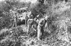 American soldiers widen dirt road near Minturno, Italy, 1944.