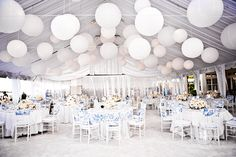 A white wedding! Tent liner, drapes, chinese lanterns, white chivaris...this is gorgeous.
