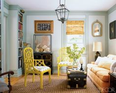 I love the paint colors Scott Currie used in his Southampton library -- the walls are painted Sea Haze and the trim is Silver Dollar, both by Benjamin Moore. The sofa is upholstered in Mulberry linen, in canteloupe, by Lulu DK. Chinese Chippendale-style chairs found in Palm Beach surround a ship captain's chest, and the framed collection of egg specimens is 19th century.   Photo by Roger Davies, Elle Décor, July/August 2009.