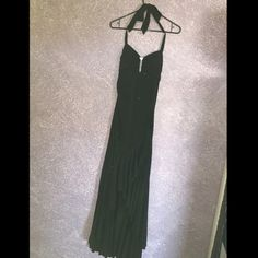 Formal dress Long black dress with pendant. Open in the back and ties at the neck. Only worn once and is in great condition Dresses Prom
