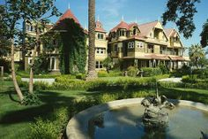 The infamously creepy Winchester House in California.  It is said to be haunted, but Sarah Winchester kept building and building add-ons to the house for the rest of her life, believing a curse was on  it and would kill her if she stopped.