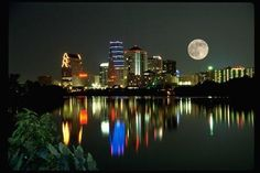 Downtown Austin, TX at sunset. Beautiful shot of the moon and downtown lights reflecting off Town Lake.