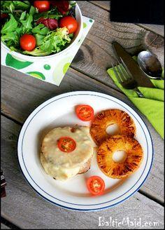 Hawaiian Pork Chops olive oil pork chops pineapple slices, fresh or canned salt, pepper sliced cheese cherry tomatoes, halved