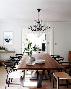 Modern dining room with modern dining room table and modern dining room chairs, wishbone dining chairs and crystal chandelier, home bar cart in neutral dining room decor, elegant dining room design Dining Room Design, Dining Room Chairs, Table And Chairs, Office Chairs, Dining Rooms, Ikea Dining, Black Dining Chairs, Farm Tables, Wood Tables