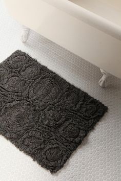 Gray Urban Outfitters bathroom rug...  This further adds to my desire for a bathroom makeover.