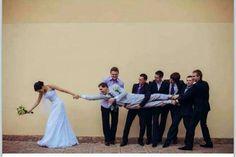 Fun groomsmen picture with husband & wife