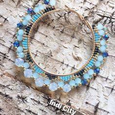 """"""" Sipiwiyiniwak"""" River People. This is probably my most beautiful set ever. I was saving these beads for a special pair. Design for me is all about highlighting the elegant simple beauty of colour and beads complimented by contemporary style as a modern infusion."""