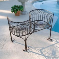 Fabulous wrought iron benches with beautiful flower in the near beaide nice pool suitable for relaxcing idea
