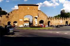 Porta Romana—the ancient stone gateway that served as the entrance to old Florence when was once a walled city. The gateway itself is a fifty-foot-tall barrier of ancient brick and stone whose primary passageway still retains its massive bolted wooden doors.