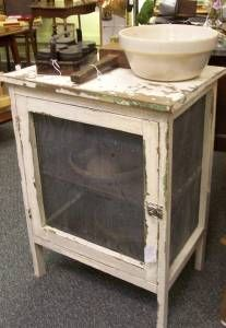 Pie Safe. I could make one like this using the old wooden screens I have.