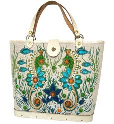 Enid Collins..love love love.  My grandmother use to have these bags.  Wish I had kept one!