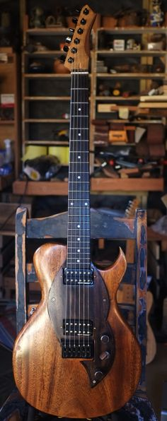 """Bear Slim Longclaw - Classic single cut design, distinctive, unique and stylish - Pair of Gibson Super Hot Dirty Fingers  humbuckers with coil tap - Super slim carved Sapele body with inlays - Unique headstock with walnut inlay - 25.5"""" scale -  Handmade walnut scratchplate with binding, knobs and switchtip"""