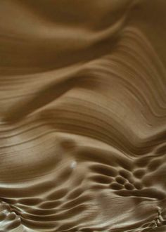 An interior surface features dynamic ripples.