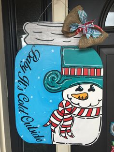 """Frosty """"baby it's cold outside"""" wooden door hanger"""