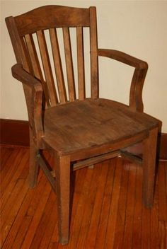 """315. Antique BANKER CHAIR desk courthouse oak gunlocke office sikes milwaukee vtg arm - Antique OFFICE CHAIR.  Solid hardwood (probably oak). Molded seat with slat seat back.  Measures 34"""" tall x 21.5"""" wide x 18"""" deep. Seat area measures 18"""" wide x 17"""" deep. Seat height is 18"""". Arm height is 27"""".  Outstanding piece. No makers mark or tag, appears to be a Gunlocke or Sikes style. Shows little to no wear. Unfinished and ready to be stained."""