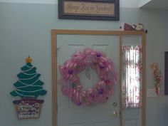 Easy to make...Deco Mesh Wreath...wire frame and deco mesh found in floral department of any store...pipe cleaners in kids craft section...create and decorate as desired...all occasions and colors...try it :) Many demo's on youtube to help!