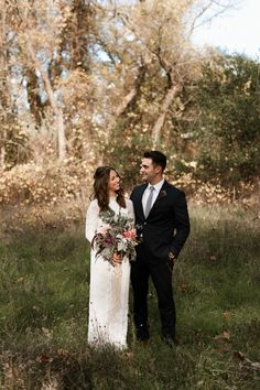 A stylish bride and groom pose for their portrait post ceremony. Bohemian wedding details with macrame back drop and cacti. By Chico Wedding Photographer Briana Morrison