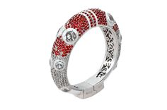 Iris Bangle from The Manhattan Collection: hand made 925 sterling silver plated with silver rhodium, hand-set with red sapphires and white topaz accented by bright white enamel
