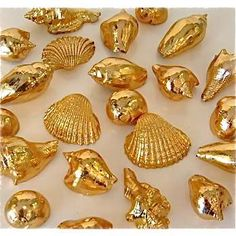 Gold Sea Shells spray painted and silver ones spray painted....oooooo...pretty!! In a bowl with sand. On the coffee table or bar..love