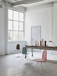 white, big table, pastel chairs