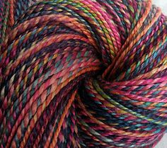 "SheepingBeauty on Etsy. ""Mardi Gras"" 2-ply hand-spun yarn from merino, angora, cultivated silk fibers, hand-painted by Woolgatherings on Etsy."