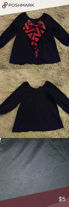 🎈🎈New Kistom black blouse with red and black bow Black satin blouse with a scoop neckline in the back. Back also has a really cute black and red Chevron bow on the back. 3/4 sleeve. Has a slight run on the lower right front and a couple of white stains on the chest, but price reflects that. Would be a perfect add on to a bundle! Newbury Kustoms Tops Blouses