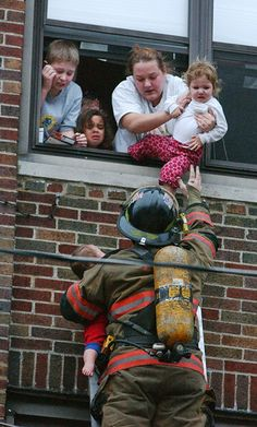 Firefighter Rescue Images | An Evansville firefighter holds a child in his left arm as he rescues ...