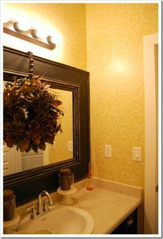 I LOVE the wreath hung over the mirror!  Entry way....