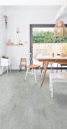 Dining room featuring Secura PUR luxury vinyl sheet flooring in Powdered Concrete