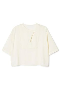 The Briella Blouse has a wide cropped fit and afluid silhouette. It is woven in alightweight cotton and viscose blend and has an overlapping neck closure in front. - Size Small measures 114,50 cm in chest circumference and 49 cm in length. The sleeve length is 25 cm.