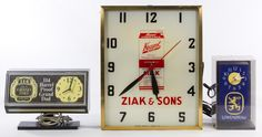 Lot 192: Electric Wall Clock Advertising Assortment; Three items including Old Grand Dad whiskey, Lowenbrau beer and Kraml milk