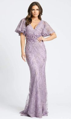 Delight the crowd when they see you in this sophisticated Mac Duggal 67493 Evening Dress. Exquisite embroidery and sparkly beadings cascades along the entire silhouette of this lace gown while showing off a V-neckline, fitted bodice and bell style short sleeves. The sheath skirt elegantly columns down to a full-length hemline and finishes with a subtle train. Inspire everyone to shower you with compliments in this Mac Duggal style for glamorous evening. Evening Gowns With Sleeves, Evening Dresses Plus Size, Prom Dresses With Sleeves, Plus Size Dresses, Hourglass Dress, Hourglass Body, Dress Websites, Mac Duggal, Beaded Gown