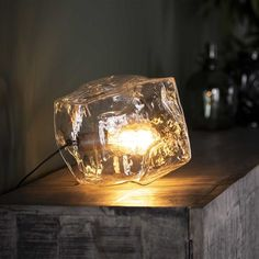 This Rock table lamp is a real eye-catcher! The table lamp is in the shape of a rock and is made out of mouth blown glass. Drop Lights, Led Lampe, Mason Jar Lamp, Fairy Lights, Clear Glass, Chrome, Ceiling Lights, Rock, Products