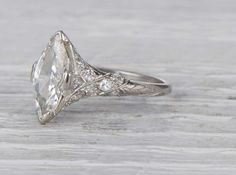 Antique Edwardian engagement ring made in platinum and centered with an approximately carat EGL certified marquise cut diamond with G-H color and clarity. Circa 1915 Lovely Edwardian features More. Platinum Engagement Rings, Antique Engagement Rings, Antique Rings, Antique Jewelry, Vintage Jewelry, Halo Engagement, Wedding Rings Vintage, Vintage Rings, Wedding Jewelry