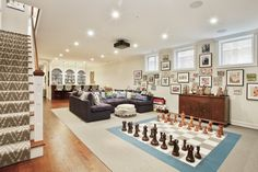 Fun game room with bar and large chess game board on the floor. Vacaville Ca, California Homes, Chess, Game Room, Playroom, Chicago, Real Estate, Entertaining, Spaces