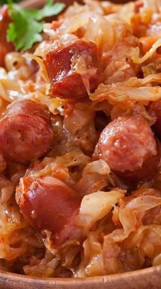 Slow Cooker Polish Bigos Recipe Sauerkraut with Polish sausages, bacon, dry red wine, and vegetables cooked in a slow cooker. Slow Cooker Huhn, Slow Cooker Recipes, Crockpot Recipes, Cooking Recipes, Healthy Recipes, Slow Cooking, Meat Recipes, Polish Sausage Recipes, Polish Recipes