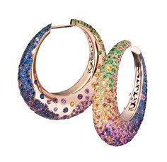 Another stunning design from de GRISOGONO's 'Melody of Colours' collection, these blackened pink gold hoops feature 186 amethysts, 217 blue sapphires, 127 yellow sapphires, 97 orange sapphires, 165 pink sapphires and 124 tsavorites.