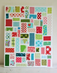 Mod Podge pieces of scrapbook paper, wall paper, or your own painted paper down on stretched canvas. Love it.
