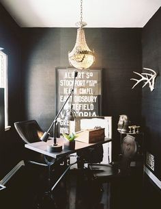 i like the sparse white antlers on the wall- especially against the black!