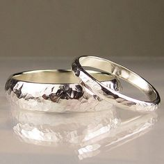I love the simplicity of these wedding bands.  (a big 'ol fat diamond would go great here!)  ;-)