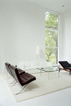 Barcelona Chairs in black. Couch in white. Dreams, in colour.