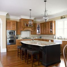 """Stained Cabinets with Black Island"" - color ideas for the island"