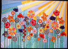 Beautiful quilt! Love the bright colors and wildflower/prairie sun icons.